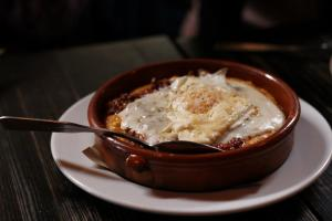 Polenta & Sausage Ragu with mozzarella & over easy egg from Tasty N Sons (Photo Credit to Freddierick John Photography